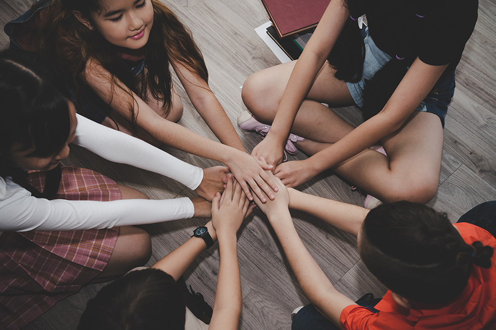 group-diverse-children-join-hands-activity-teamwork-education-concept--web